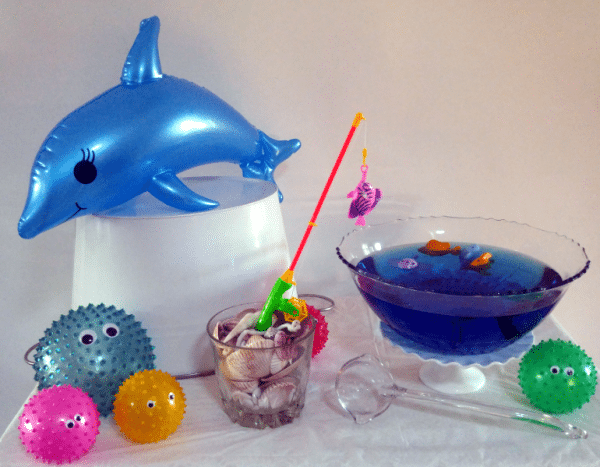 Fishing hole punch bowl with shells and fishing rod at sea party