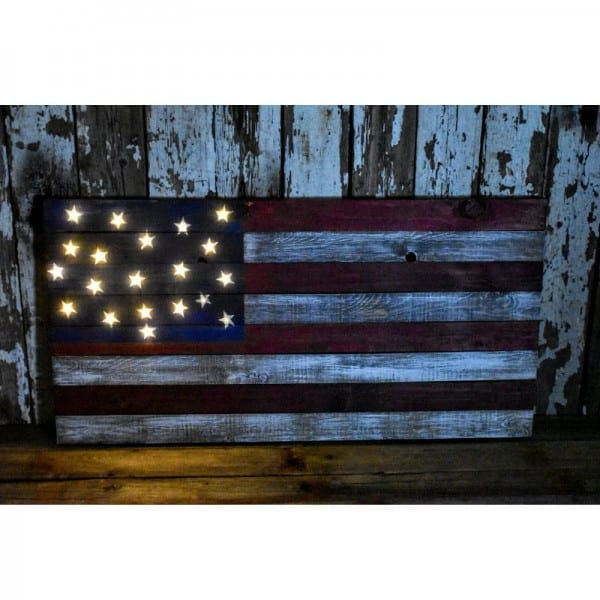 DIY Light-Up Pallet Flag shown at night with all stars lit up.