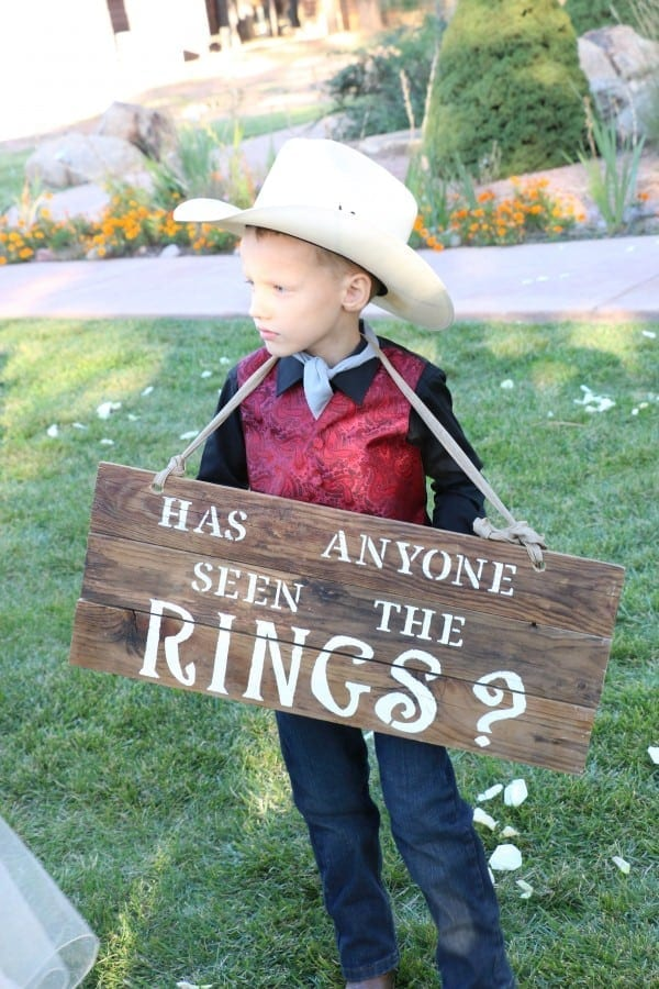 Ring Bearer holding sign during ceremony.
