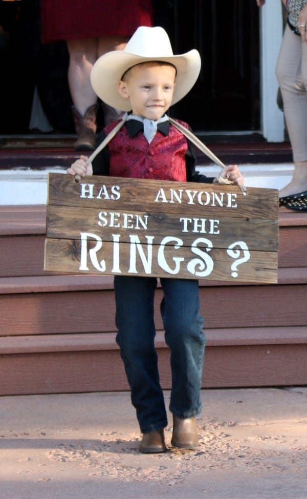Ring Bearer carrying sign during wedding.