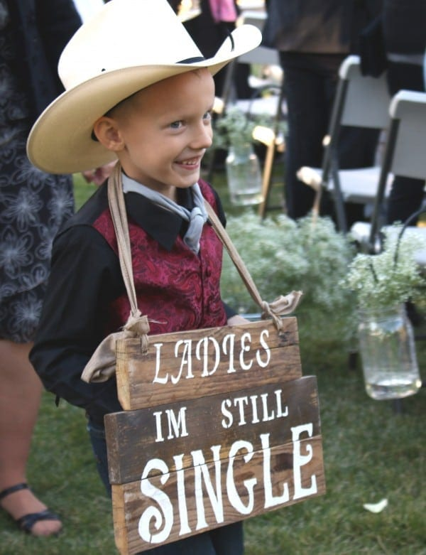 Ring bearer holding sign # 2.