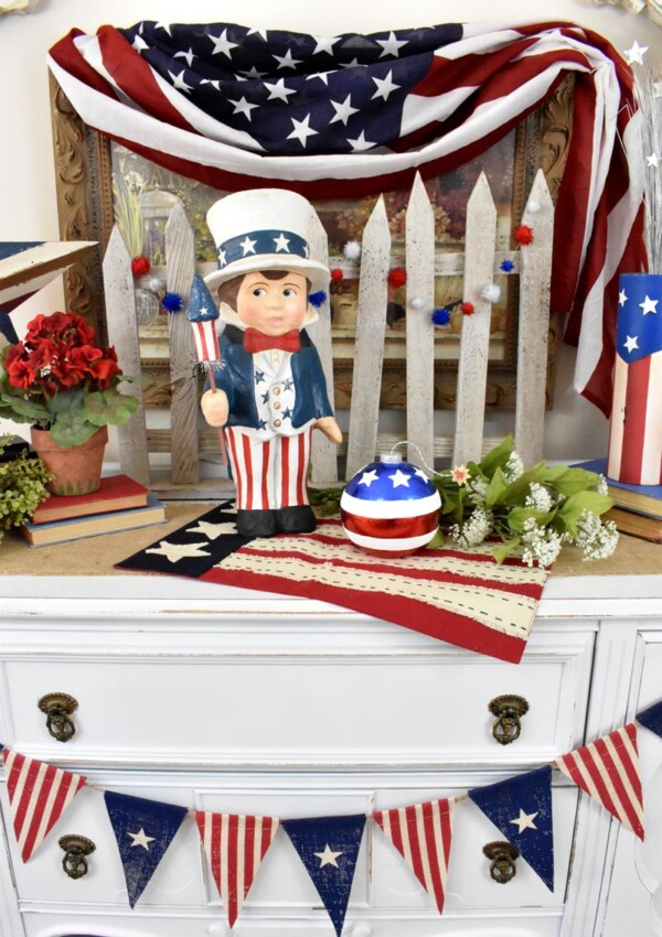 Red, white and blue banner drapes across the buffet for patriotic look. Sammys Star Spangled Banner Vignette
